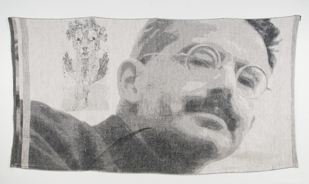 A digitally woven tapestry featuring an image of Walter Benjamin and his Angel of History