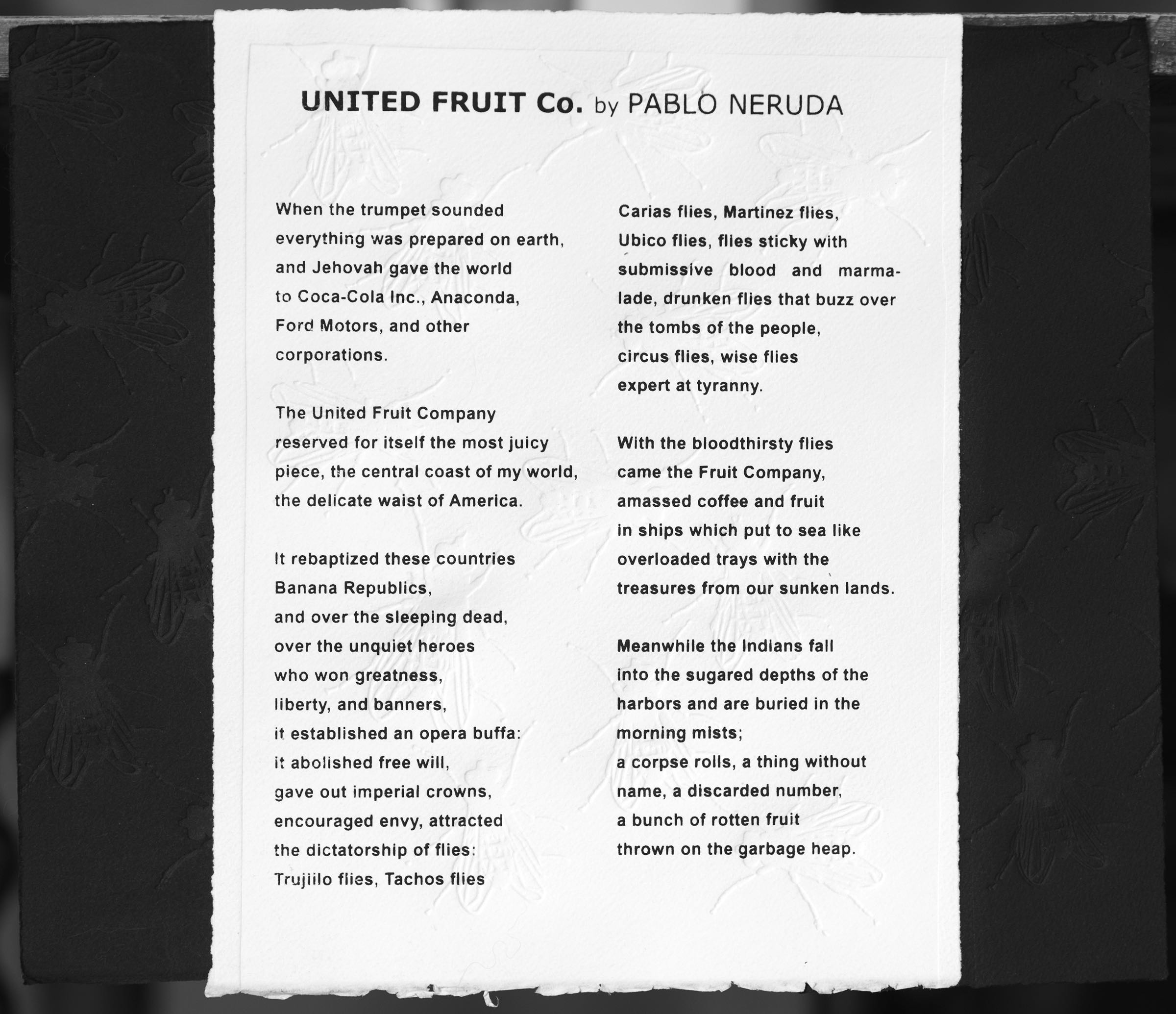 Neruda embossment featuring poem by Pablo Neruda and embossed flies.